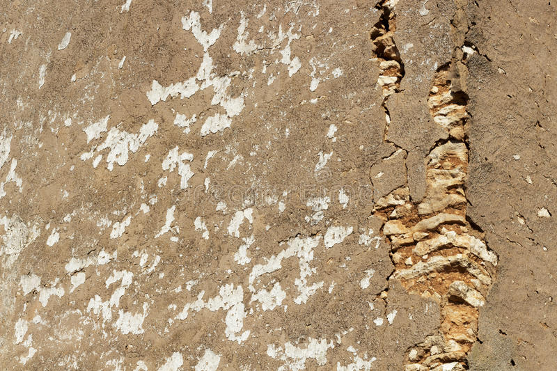 Stone wall of an abandoned farmhouse. Wallpaper. Texture of an old stonewall that is part of an abandoned farmhouse. Architectonic detail royalty free stock photography
