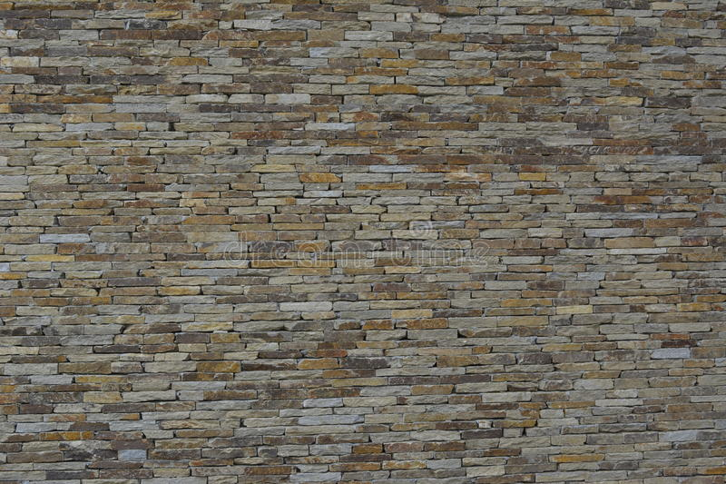 Stone wall. Abstract background . Stone wall. Gneiss royalty free stock image