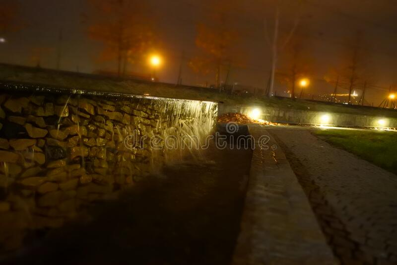 Stone wall along roadway stock image