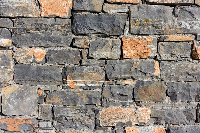 Stone wall as a background or texture. An example of masonry as cladding of external walls. stock photo
