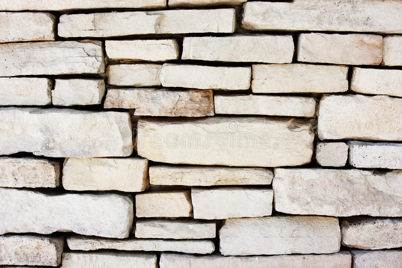 Stone wall background. Stone wall detail with modern white bricks stock photography