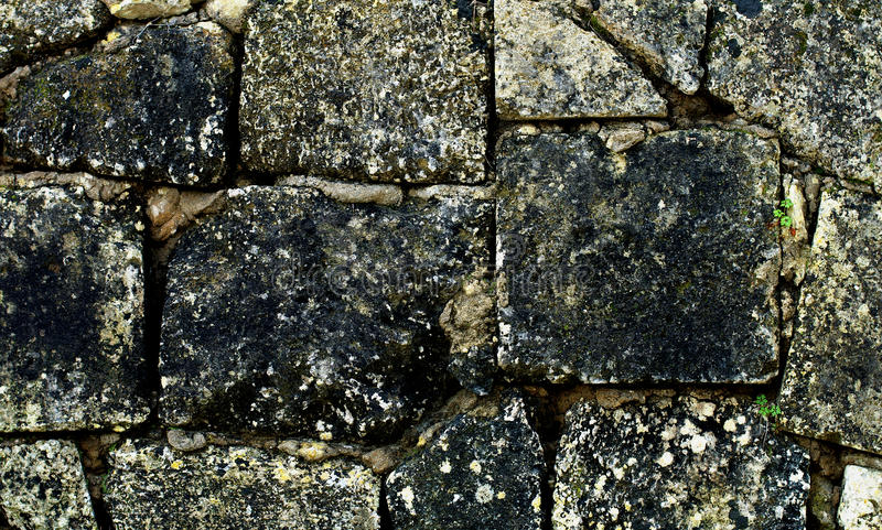 Stone Wall Background. Ancient Stone Wall Background with Square Shape Weathered Blocks closeup Outdoors royalty free stock images