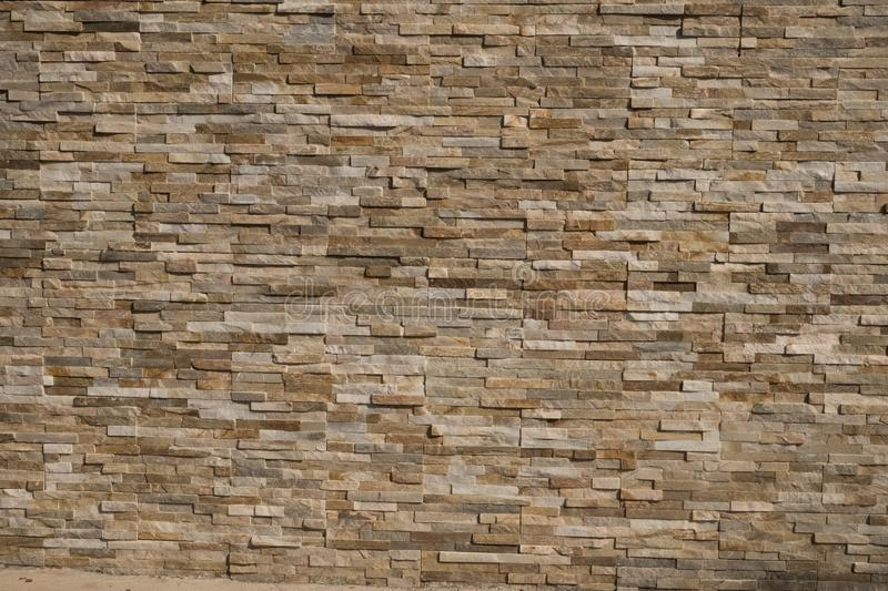 Stone Wall background from modern building contruction facade.  royalty free stock photo