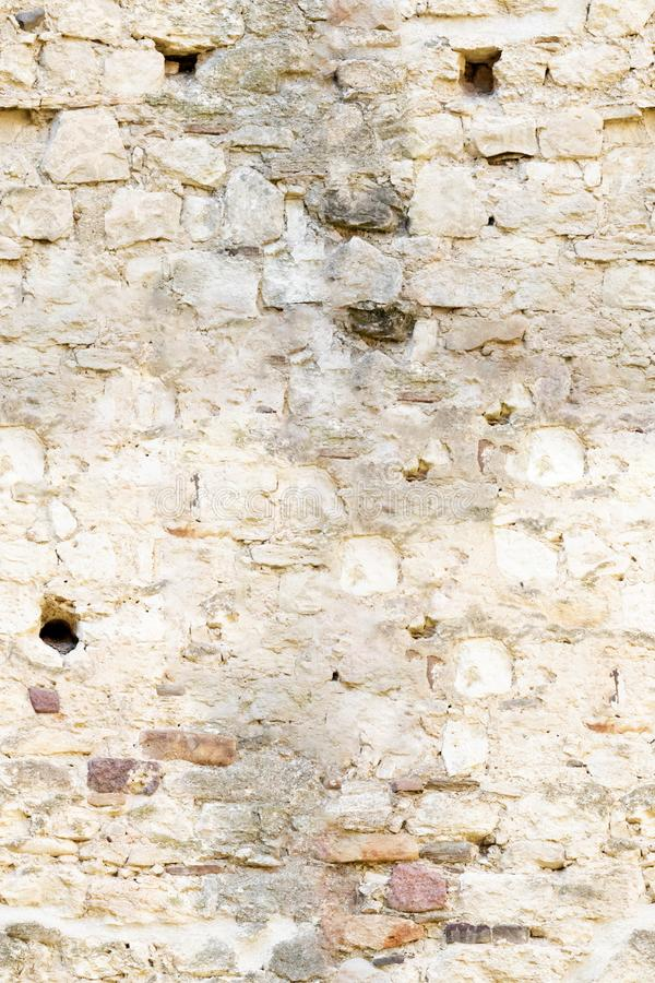 Stone wall for background, natural color texture of seamless stone royalty free stock images