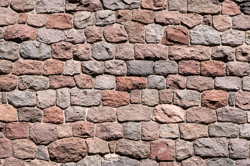 Stone wall background of natural stones royalty free stock photo