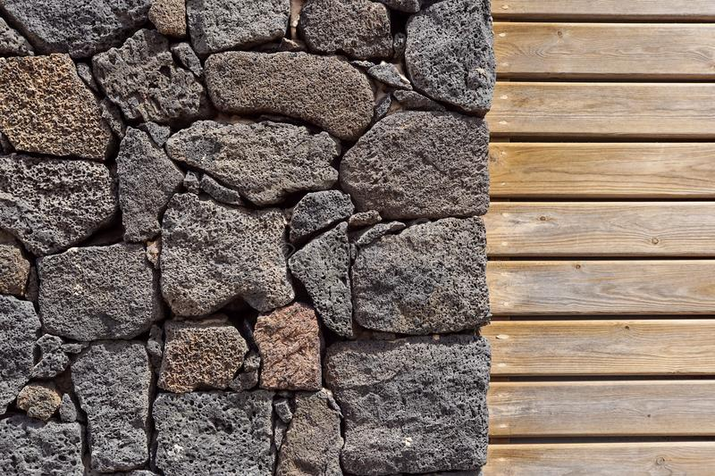 Stone wall background. stone and wood wall, wood texture as background. Wood background wall . Stone wall background. stone and wood wall, wood texture as royalty free stock image