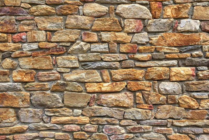 Stone wall background. Stylish stone wall background closeup view royalty free stock images