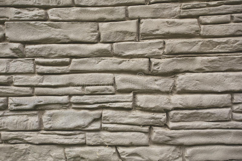 Stone wall background. Stylish stone wall background closeup view stock photography