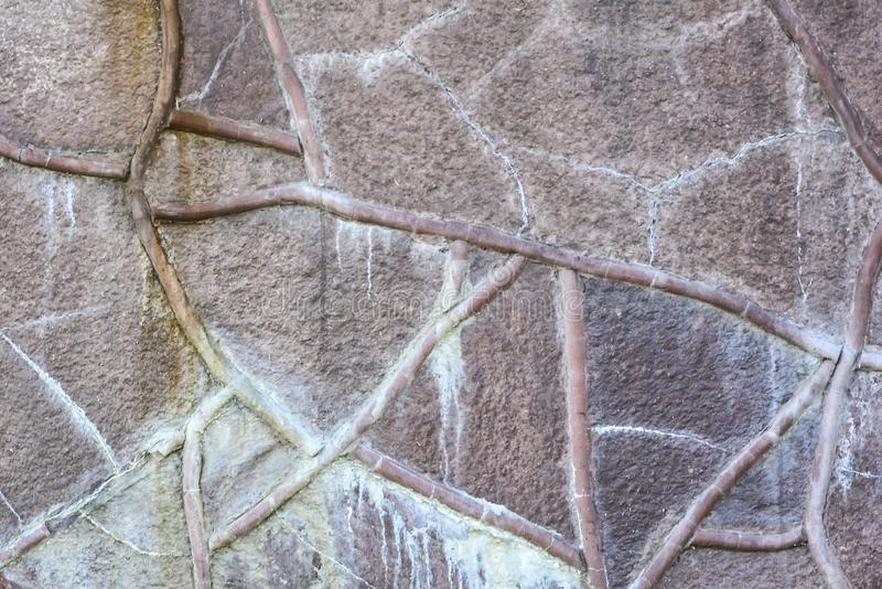 Stone wall background. The wall texture of large stones of various shapes and sizes royalty free stock photos