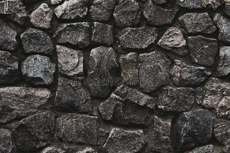 Stone wall background. Wall cement background. Old cement texture. Concrete surface. Black dark background. Brick wall background. royalty free stock image