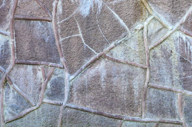 Stone wall background. The wall texture of large stones of various shapes and sizes royalty free stock photography