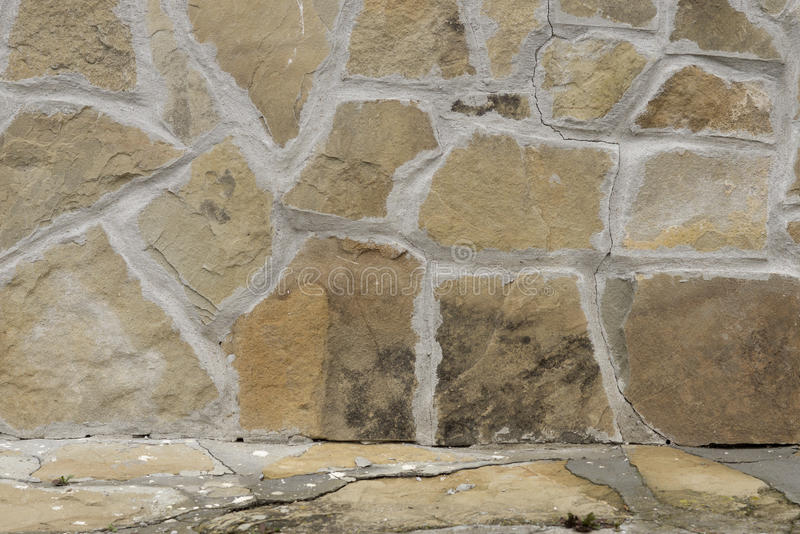 Stone wall in beige and brown stock photo