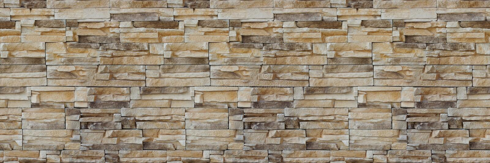 Stone wall brick texture. Seamless pattern. Background of the Sandstone facade. stock photos