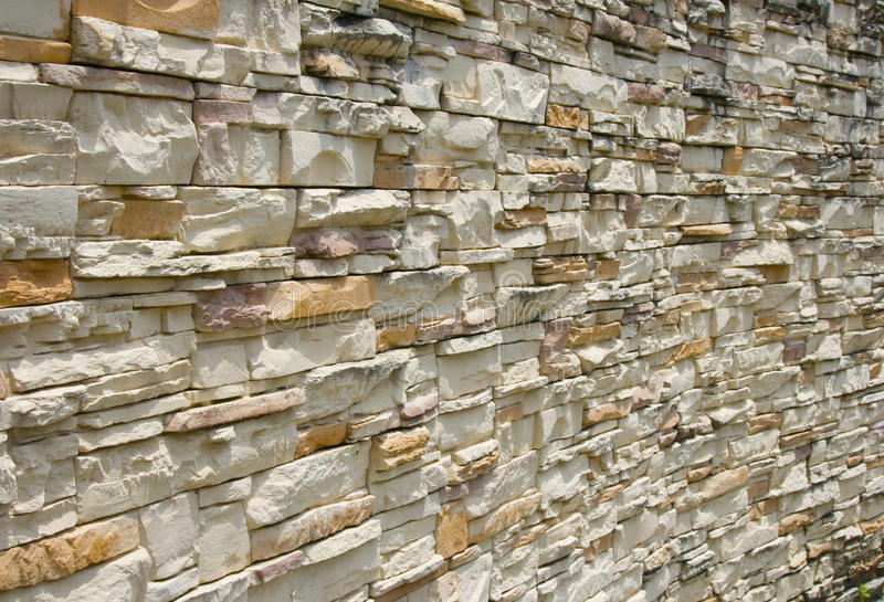 Stone wall cladding. Detail of natural stone wall cladding stock photo