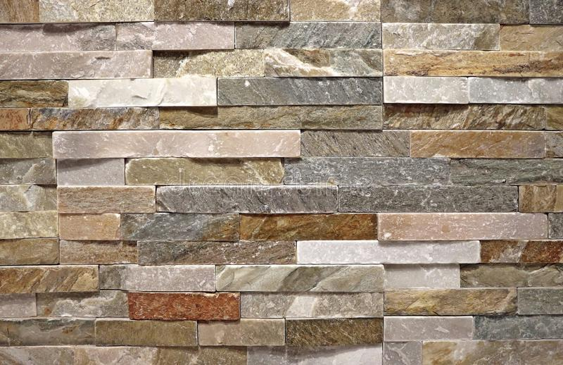 Stone Wall Cladding Made Of Natural Strip Rocks. Colors Are  Pink,white,brown,gray. Stock Photo - Image of pattern, exterior: 160627396