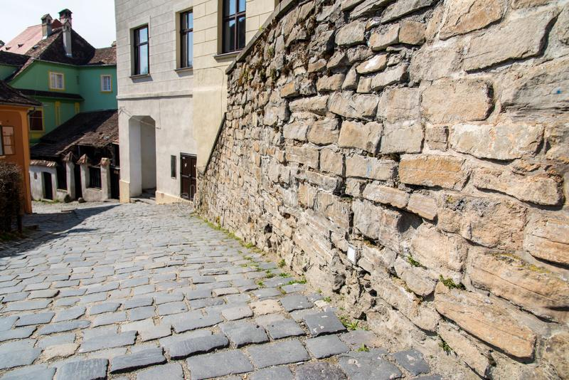 Stone wall close up shot on colorful medieval streets. Of Sighisoara, Romania stock photo