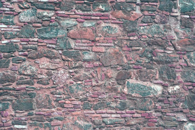 Stone wall Close-up. Texture. Part of the old stone castle wall. stock photos