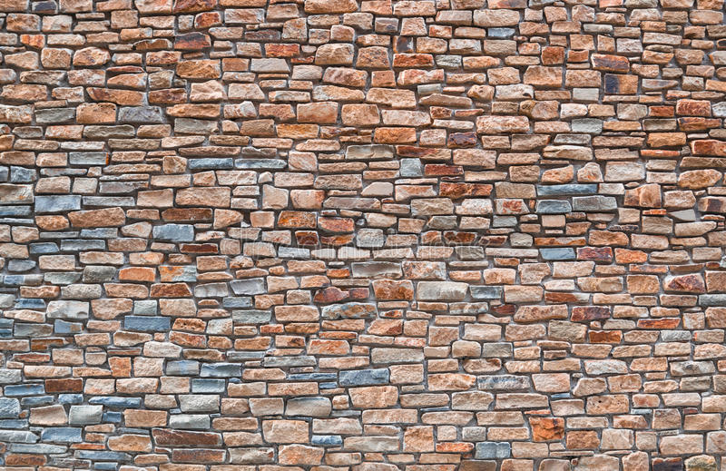 Stone wall. Colored stone wall as background royalty free stock photo