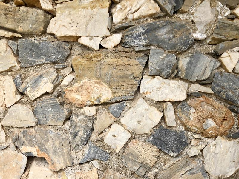 Stone wall for texture or background, close-up details. Stone wall with cracks for texture or background, close-up details stock photos