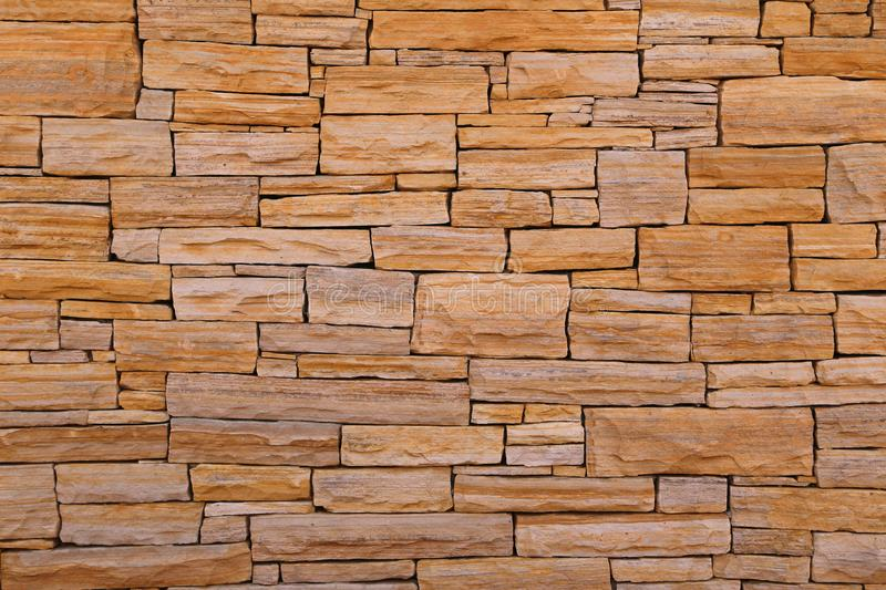 Stone wall. Detail of natural stone wall cladding. Great for background photos on laptops, mobile phones and computers royalty free stock image