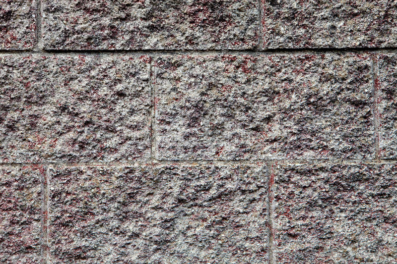 Stone wall. Details of the construction of a stone wall royalty free stock photo