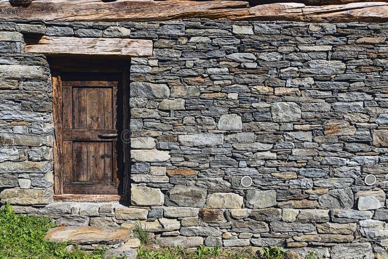 Stone wall and door royalty free stock photo