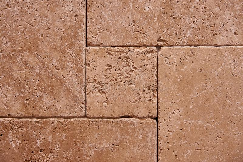 stone wall of durable tiles royalty free stock image