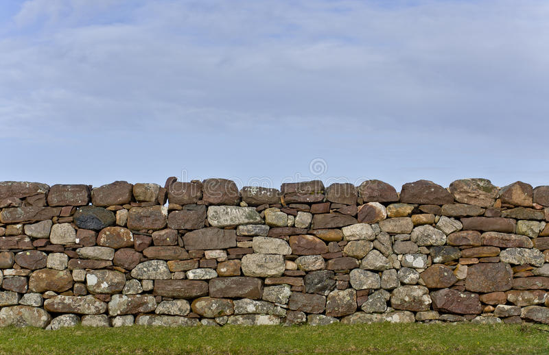 Download Stone Wall In Evening Light With Grass And Sky Stock Image - Image: 23285001