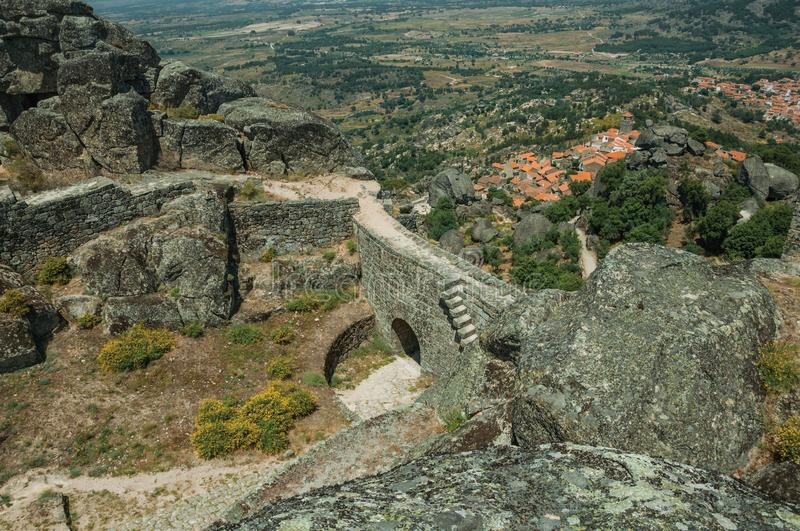 Stone wall with gateway and landscape at the Castle of Monsanto. Stone wall with gateway in a castle on rocky hilltop, with countryside landscape and the royalty free stock images