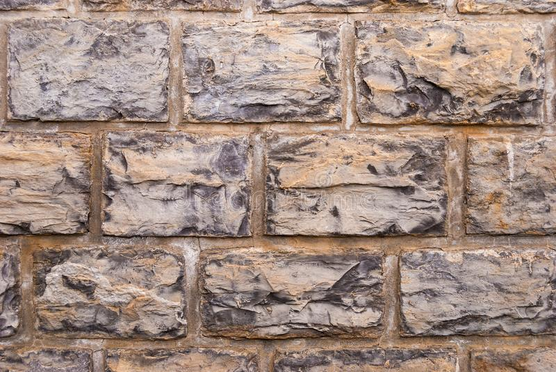 Stone wall grey brick stones texture background.  stock photos