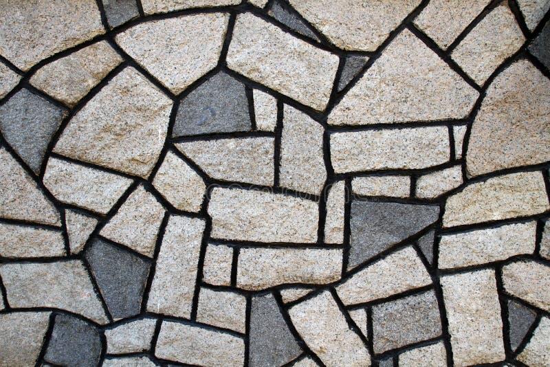 Stone Wall with irregular shape stone royalty free stock photos