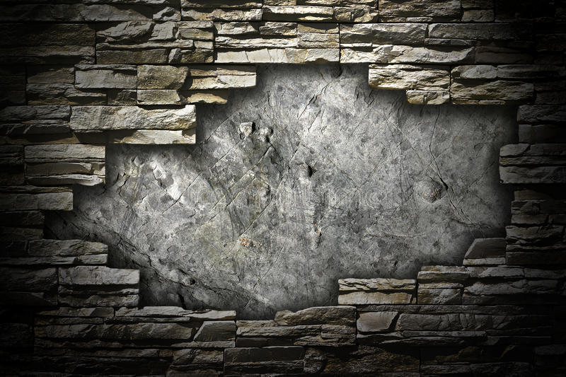 Stone wall with a large hole in the middle. Of a grunge style royalty free stock image