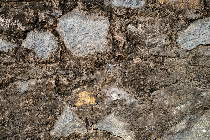 A stone wall made of large stones. Background. royalty free stock photography