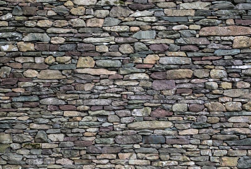 Stone wall of mixed slate stock photography