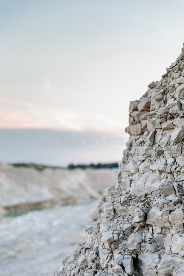 Stone wall at a mountain lake royalty free stock photography