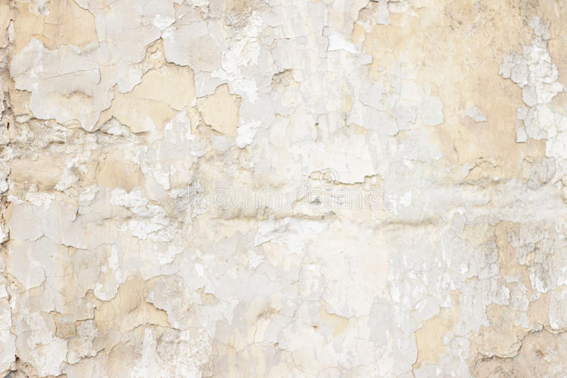 Stone wall with a multilayered old tumbling whitewash texture. Stone wall with a multilayered old tumbling whitewash Abstract background texture stock photo