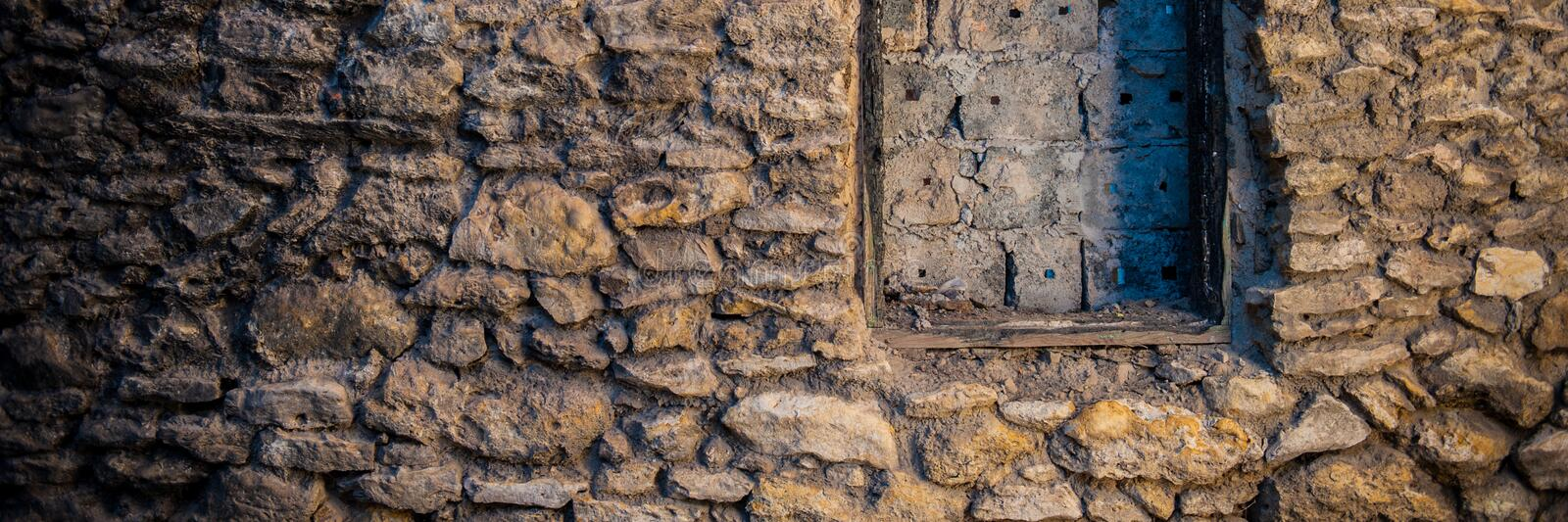 Stone wall of an old house. Banner for design stock image