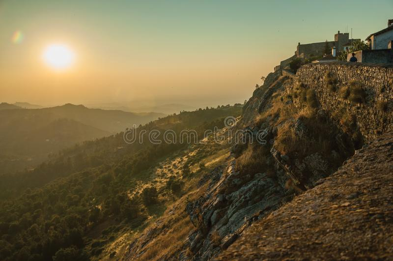 Stone wall and old houses over rocky cliff in Marvao royalty free stock images