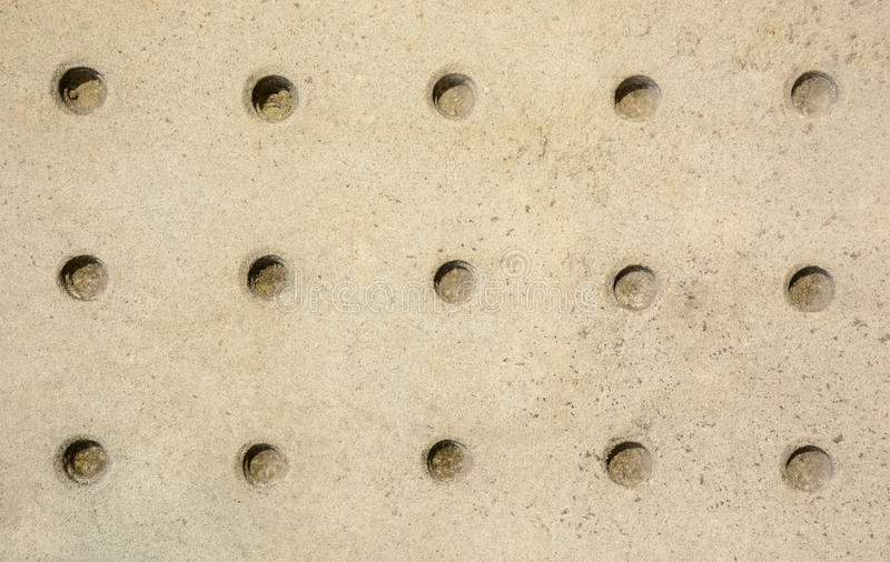 Stone wall patterned with round holes texture background stock photo