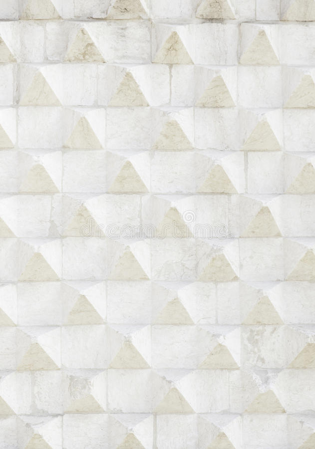 Stone wall with reliefs of triangle stock photos