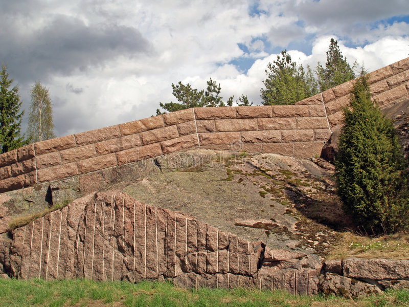 Download A stone wall on a rock stock photo. Image of strong, protection - 1015570