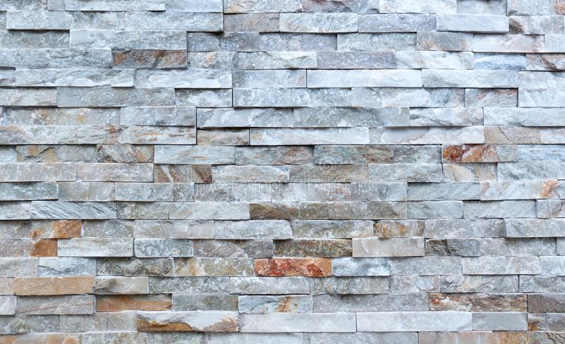 Stone wall of rough elongated facing stones. Detail of a stone wall of rough elongated facing stones stock images