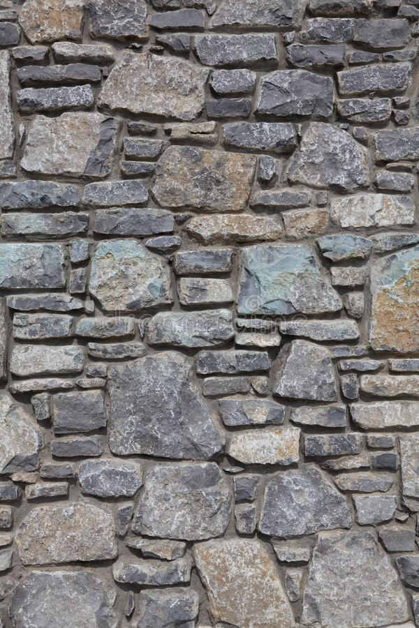 Stone wall texture. Slate stone wall textured background