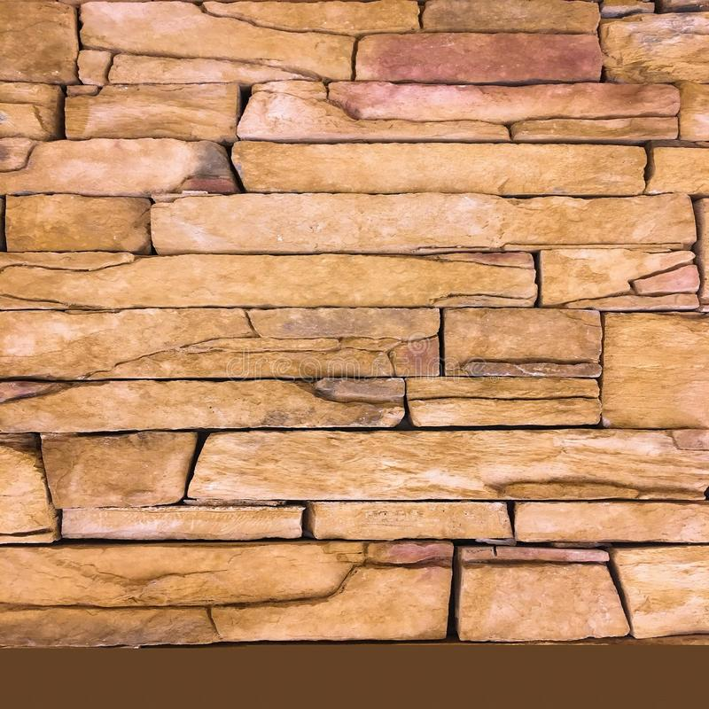 Stone wall texture as background. Cracked concrete vintage block stone wall background, old painted wall. Background wall painting stock photo