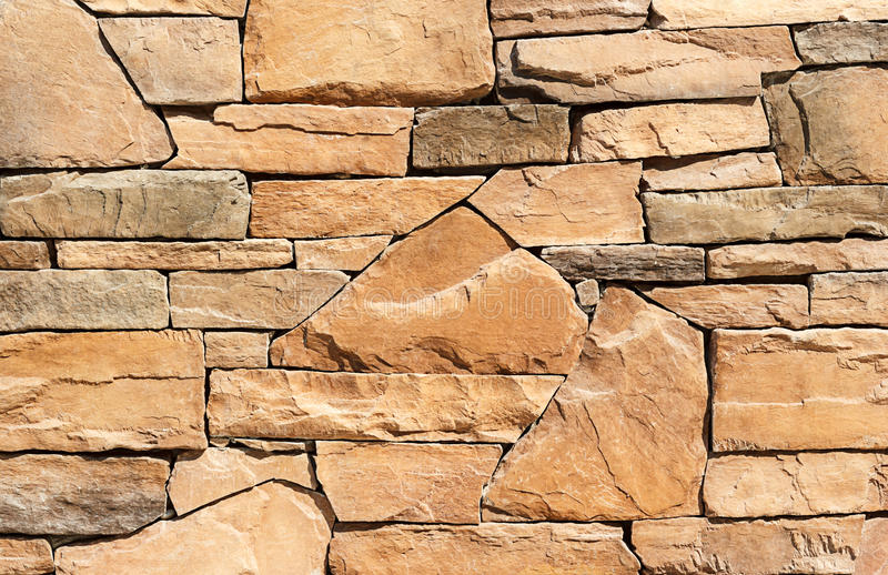 Stone wall texture or background. Brown color stock image