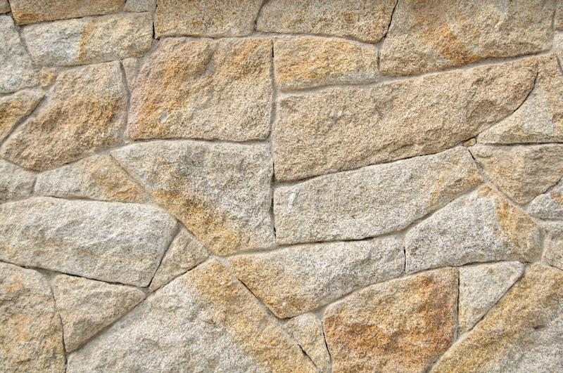 Stone Wall Texture for Background and Design Art Work. Simple grungy stone wall as seamless pattern texture background or as art design overlay. Building old royalty free stock photo