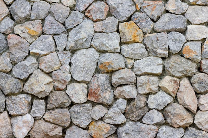 Stone wall texture or background in gray tone look like  vintage style royalty free stock image