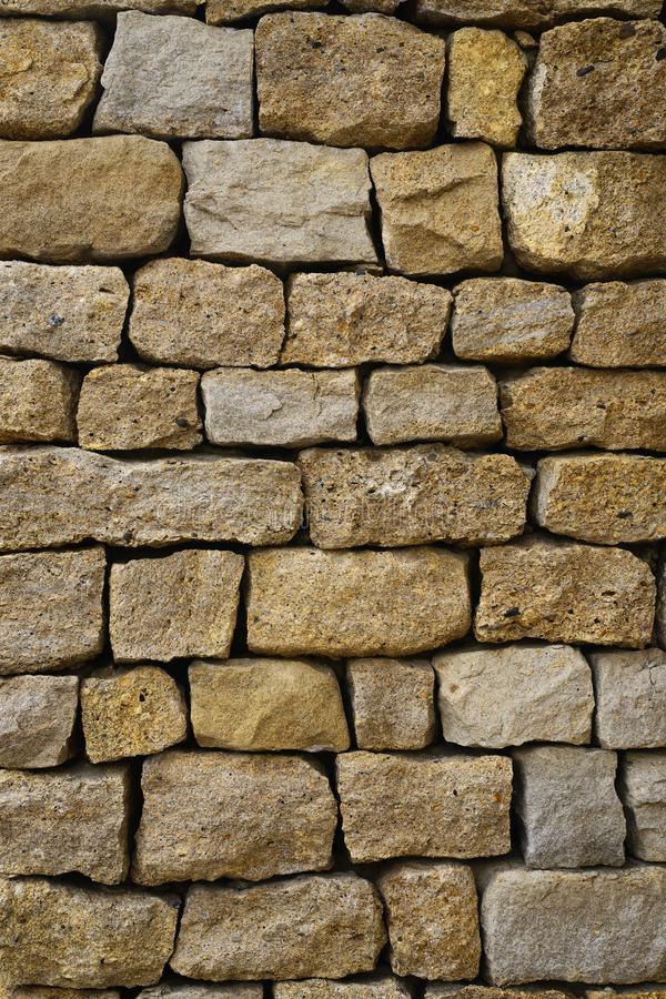 Stone wall texture. Background of a wall with a texture of natural stone stock images