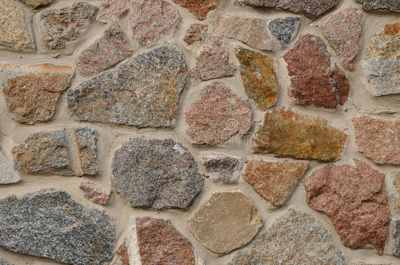 Stone wall texture background natural color. stock images
