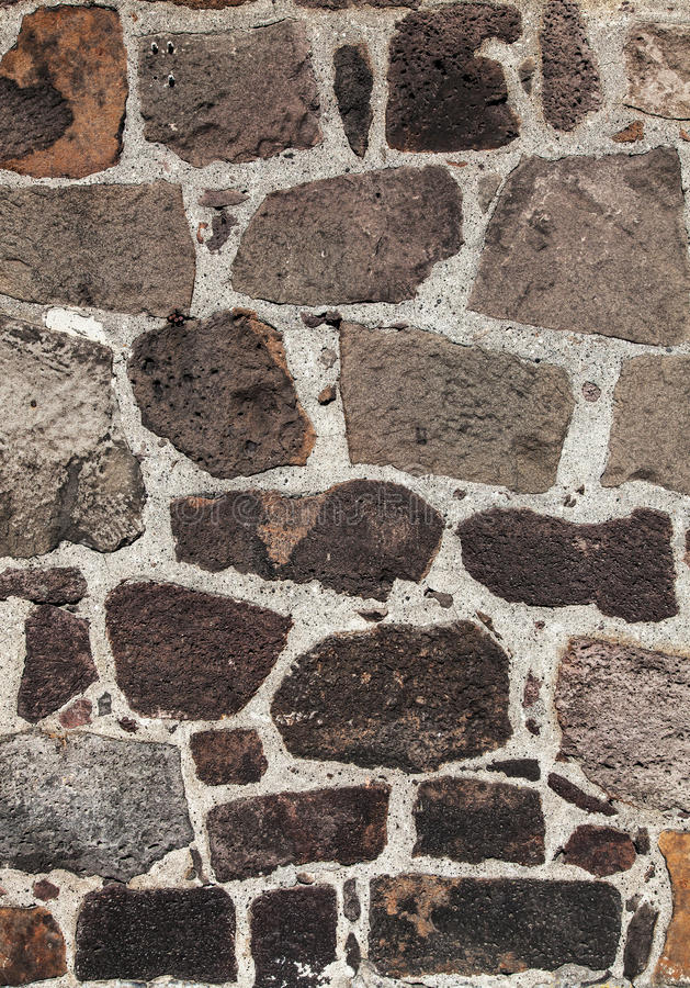 Stone wall texture. Big rock pieces stock photography